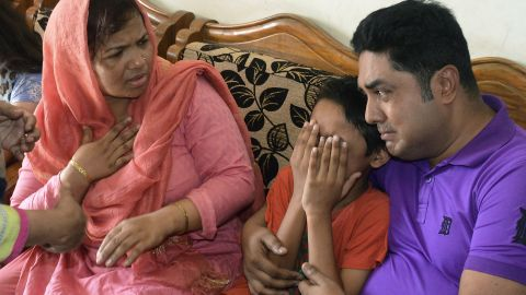 The family of Mahmuda Khanam Mitu, the wife of a top Bangladeshi anti-terror officer slain in the street, mourn her death Sunday.