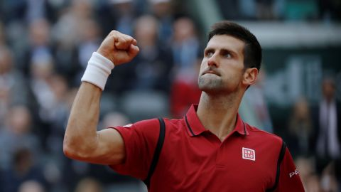 Novak Djokovic beats Andy Murray 3-6, 6-1, 6-2, 6-4 to win the French Open and complete a career grand slam.