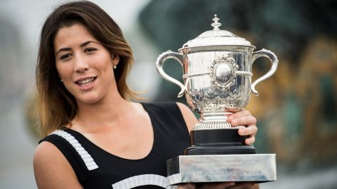 Spain's Garbine Muguruza poses for photographers with her trophy one day after winning her women's final match against US player Serena Williams at the Roland Garros 2016 French Tennis Open on June 5, 2016 at Place de la Concorde in Paris. AFP PHOTO / MARTIN BUREAU / AFP / MARTIN BUREAU        (Photo credit should read MARTIN BUREAU/AFP/Getty Images)