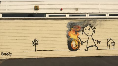 Elusive street artist Banksy sneaked into a primary school in his hometown of Bristol, Britain, to paint a mural for some of his youngest admirers.