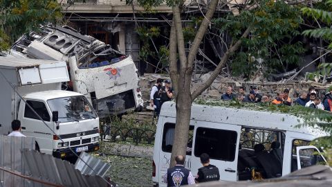 Police officers work at the scene of a car bombing in Istanbul on Tuesday, June 7. At least 11 people were killed and 36 were injured when a car bomb targeted a police bus, according to Turkey's state-run Anadolu agency.