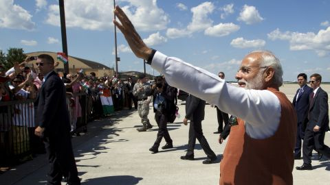 Modi waves after arriving at Andrews Air Force Base in Maryland.