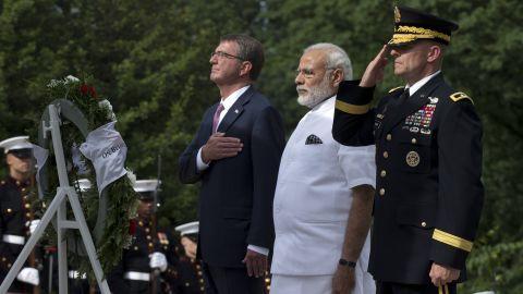 Modi is flanked by U.S. Secretary of Defense Ash Carter, left, and U.S. Army Maj. Gen. Bradley A. Becker.
