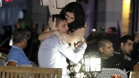 Israelis embrace following a shooting attack at a shopping complex in the Mediterranean coastal city of Tel Aviv on June 8, 2016.At least three people were killed and several wounded in the shooting spree, emergency services said. Police said that it appeared to be a militant attack, but they could not immediately give any details of the attacker or victims. / AFP / JACK GUEZ        (Photo credit should read JACK GUEZ/AFP/Getty Images)