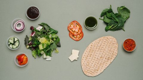 For vegetarians, the tomato mozzarella flatbread and classic salad combo is lower in sodium compared with other meals with tomatoes, such a slice of pizza, and has a satisfying amount of fiber and protein.