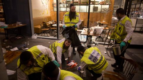 TEL AVIV, ISRAEL - JUNE 08:  Members of an Israeli ZAKA - Identification, Extraction and Rescue team work at the scene of a shooting outside Max Brenner restaurant in Sarona Market  on June 8, 2016 in Tel Aviv, Israel. According to police reports, four Israelis were killed and several others wounded when two Palestinian gunmen open fire at the food and retail complex in central Tel Aviv.  (Photo by Lior Mizrahi/Getty Images)
