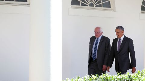 Democratic presidential candidate Sen. Bernie Sanders walks with President Barack Obama through the Colonnade as he arrives at the White House for an Oval Office meeting June 9, 2016 in Washington, DC.