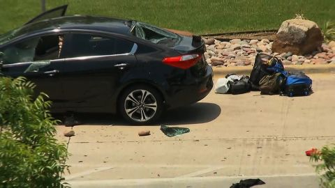 The incident began at this car outside baggage claim, where the man used large landscaping rocks to break the windows, Dallas police said.