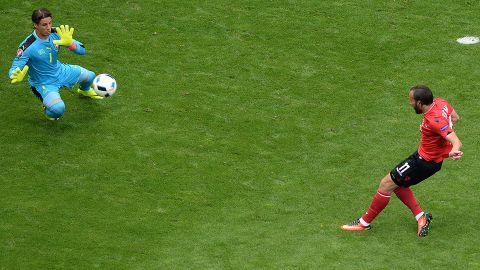 Albania's midfielder Shkelzen Gashi, right, misses a goal opportunity as Switzerland's goalkeeper Yann Sommer stops the ball.