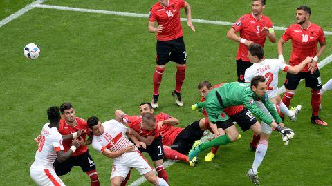 Switzerland's defender Fabian Schaer, second right,  heads the ball to score.