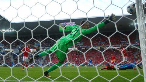 The header of Adam Nemec of Slovakia hits the goal post.