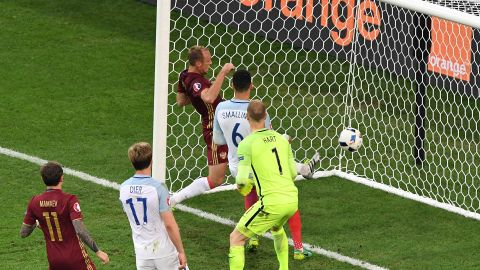 """England's goalkeeper Joe Hart, center, looks at the ball going into his net as Russia scores at the end of the game.  Russia's <a href=""""http://www.cnn.com/2016/06/11/football/england-russia-euro-2016/index.html"""">92nd minute equalizer</a> denied England victory."""