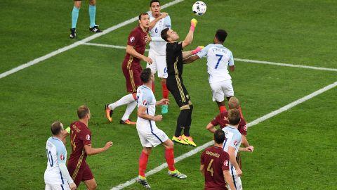 Russia goalkeeper Igor Akinfeev boxes the ball.