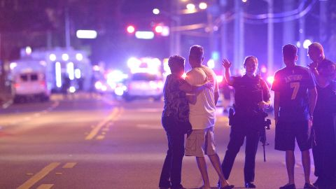 """Police direct family members away from the scene of a shooting at the Pulse nightclub in Orlando in June 2016. Omar Mateen, 29, <a href=""""http://www.cnn.com/2016/06/12/us/orlando-nightclub-shooting/index.html"""" target=""""_blank"""">opened fire inside the club,</a> killing at least 49 people and injuring more than 50. Police fatally shot Mateen during an operation to free hostages that officials say he was holding at the club."""