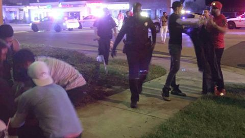 Police officers respond to the scene of the shooting.