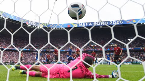 Turkish goalkeeper Volkan Babacan is unable to save Modric's long-range effort.