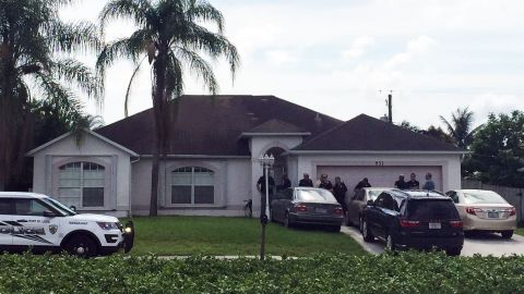 Police gather outside the home in Port St. Lucie, Florida, where Mateen's father lives.