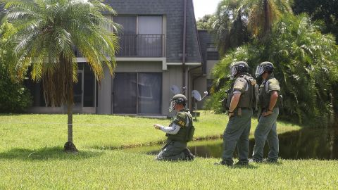 A bomb disposal unit checks for explosives around the apartment building where Mateen is believed to have lived in Fort Pierce, Florida.