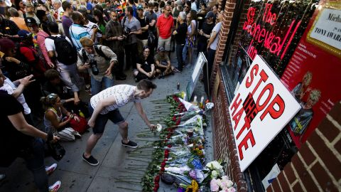 """People gather for a vigil June 12 outside the Stonewall Inn in New York. <a href=""""http://www.cnn.com/2016/05/09/travel/stonewall-inn-nps-national-monument-gay-rights/index.html"""" target=""""_blank"""">Stonewall</a> is considered the birthplace of the gay rights movement."""