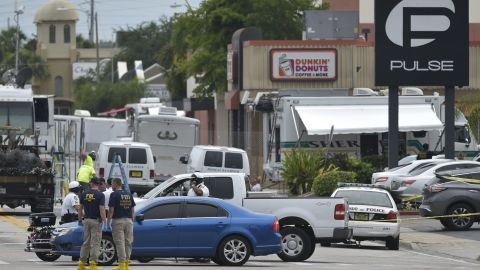 """Police and investigators work near the area of the mass shooting at the Pulse nightclub on in Orlando, Florida on June 12, 2016. A somber President Barack Obama  expressed grief and outrage at the """"horrific massacre"""" of 50 late-night revelers at an Orlando gay club, branding it an act of terror and hate. / AFP / Mandel Ngan        (Photo credit should read MANDEL NGAN/AFP/Getty Images)"""