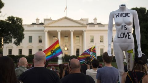 """Mourners gather during a vigil in front of the White House on June 12. President Barack Obama called the mass shooting an """"act of terror"""" in remarks to the nation."""