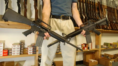 DENVER - SEPTEMBER 13:  The Manager of Dave's Guns holds two Colt AR-15's, the gun on the right has a bayonet mount, flash suppressor and a collapsible stock and accepts high capacity magazines that hold over 30 rounds and can be purchased by civilians as of today, the gun on the left was legal to purchase and own with a 10 round magazine September 13, 2004 in Denver, Colorado. Between 1994 and September 13, 2004 the AR-15 with the above items could only be sold to law enforcement and military but is now legal for civilians to purchase due to the expiration of the Brady Bill.  (Photo by Thomas Cooper/Getty Images)