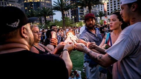 """People light candles during a vigil one day after a<a href=""""http://www.cnn.com/2016/06/12/us/gallery/orlando-shooting/index.html"""" target=""""_blank""""> gunman killed 49 people</a> at a gay nightclub, marking the <a href=""""http://www.cnn.com/2013/07/19/us/gallery/worst-shootings-in-us/index.html"""" target=""""_blank"""">deadliest mass shooting in U.S. history</a>."""