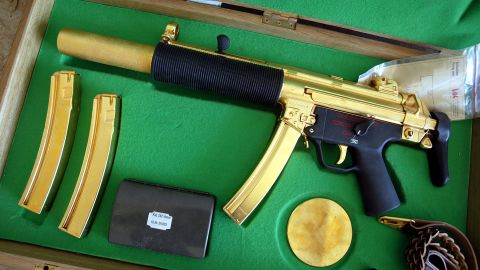 A gold-plated ceremonial MP5 submachine gun was displayed after its discovery near the Saddam Hussein's Republican Presidential Palace on April 14, 2003 in Bagdhad, Iraq. The weapon is designed to be stealthily fired while the briefcase is closed.
