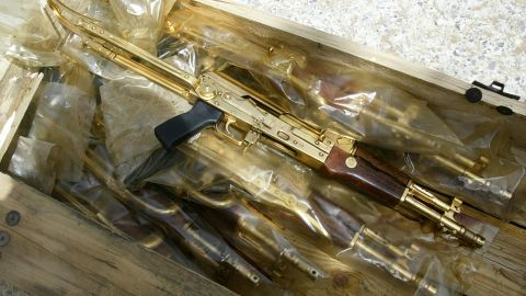 """Gold Kalashnikov rifles with the Arabic inscription """"A gift from Iraqi President Saddam Hussein"""" were found in plastic bags in Baghdad, on April 12, 2003."""