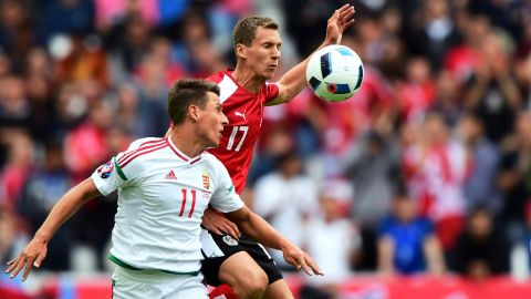 Hungary's Krisztian Nemeth, left, competes against Austria's Florian Klein.