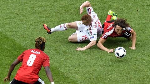 Austrian midfielder Julian Baumgartlinger, right, clashes with Hungarian midfielder Laszlo Kleinheisler.