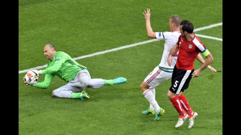 Hungary goalkeeper Gabor Kiraly makes a save. The 40-year-old is now the oldest player ever to compete in the Euros.