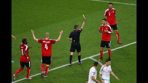 Austria defender Aleksandar Dragovic receives his second yellow card in the 66th minute. Austria played with 10 men for the rest of the match.