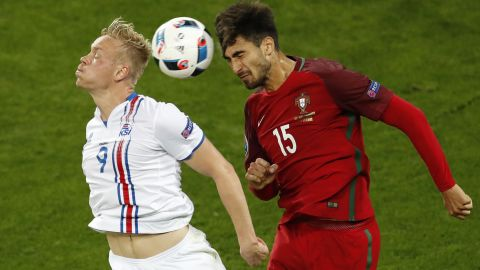 Iceland's Kolbeinn Sigthorsson, left, jumps for a header with Portugal's Andre Gomes.