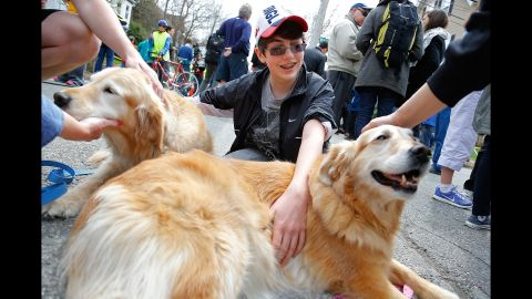After the Boston Marathon bombing in April 2013, A.J. Feltner Harrison pets two certified therapy dogs, Archie, left, and Diva. The 13-year-old witnessed the initial shots fired when bomber Dzhokhar Tsarnaev was caught in Watertown, Massachusetts. The bombing, which occurred at the finish line of the marathon, killed three people and wounded at least 180.
