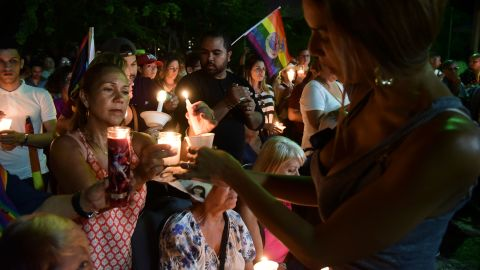 People remember the victims during a vigil at an LGBT community center in San Juan, Puerto Rico, on Tuesday, June 14.