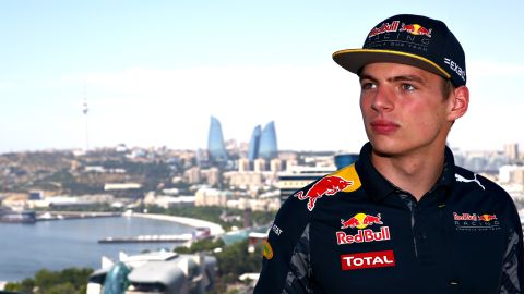 """F1's hottest property, Max Verstappen poses with Baku's iconic """"Flame Towers"""" in the background."""