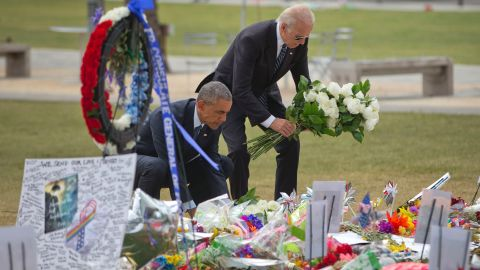 President Barack Obama and Vice President Joe Biden place flowers down during their visit to a memorial to the victims of the Pulse nightclub shooting, Thursday, June 16, 2016 in Orlando, Fla. Offering sympathy but no easy answers, Obama came to Orlando to try to console those mourning the deadliest shooting in modern U.S history. (AP Photo/Pablo Martinez Monsivais)