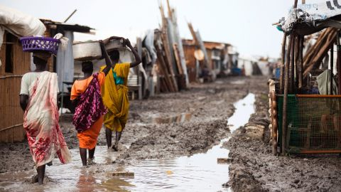 Women carry their belongings inside the Protection of Civilians (PoC) site in Malakal, South Sudan, on June 14.