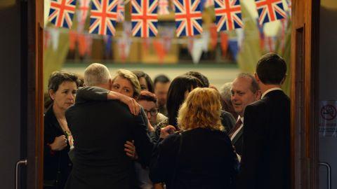 Parliament member Yvette Cooper, left, embraces Bishop Nick Baines after attending a Birstall vigil for Cox on Thursday, June 16.