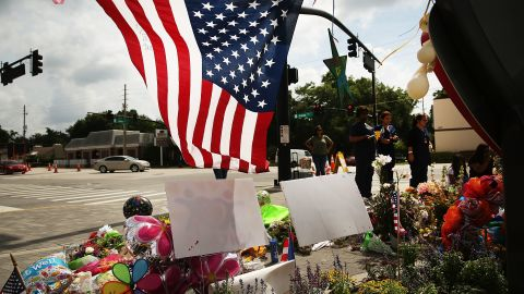 ORLANDO, FL - JUNE 17:  People visit a memorial down the road from the Pulse nightclub on June 17, 2016 in Orlando, Florida. Omar Mir Seddique Mateen killed 49 people and wounded 53 others at the popular gay nightclub early Sunday.  (Photo by Spencer Platt/Getty Images)