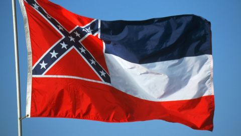 """Adopted by the Mississippi Legislature in 1894. The thirteen stars, sometimes said to represent the number Confederate States and those that might have been Confederate, are said to represent the """"original number of States of the Union"""" in the original description"""