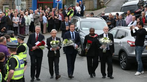 British Prime Minister David Cameron, center, joins other political leaders in paying their respects to slain Parliament member Jo Cox on Friday, June 17. Cox, 41, was stabbed and shot in Birstall, England, after a meeting with her constituents. A 52-year old man, Tommy Mair, is being held in police custody in connection with her death.