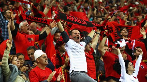 LYON, FRANCE - JUNE 19: Albania supporters celebrate their team's first goal during the UEFA EURO 2016 Group A match between Romania and Albania at Stade des Lumieres on June 19, 2016 in Lyon, France.  (Photo by Clive Brunskill/Getty Images)