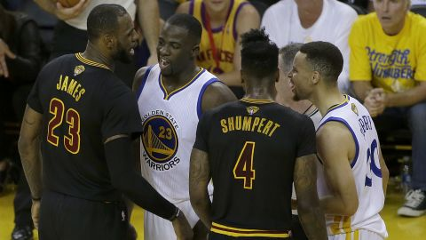 James and Curry are separated by Green and Iman Shumpert during a first-half skirmish.