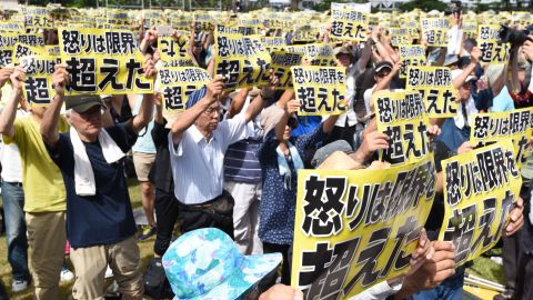 """Crimes committed by American personnel have angered the Okinawa population for decades. Demonstrators held placards that read """"our fury has gone beyond the limit."""""""