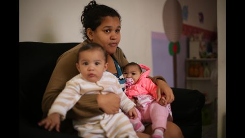 """Jacqueline Silva de Oliveira with her twins Lucas and Laura. """"No one asks God for a special needs child,"""" said de Oliveira.  """"But, I feel privileged to know that if the protective gene is discovered, it will be able to free other children of this disease, this brain malformation."""""""