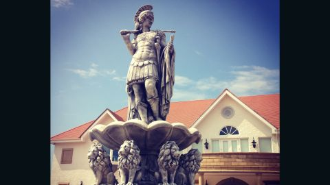 """A Roman statue adorns a fountain outside the Turnberry clubhouse on what McDines describes as """"one of the best golf courses in the world, if not the best."""""""