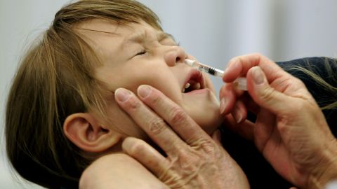 FILE- In this Oct. 4, 2005 file photo, a Danielle Holland reacts as she is given a FluMist influenza vaccination in St. Leonard, Md. On Wednesday, June 22, 2016, federal officials reported the latest in a growing series of study findings that show AstraZeneca's nasally-administered FluMist has not been working. (AP Photo/Chris Gardner, File)
