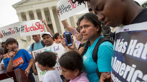 WASHINGTON, DC - JUNE 23: Families react to news on a Supreme Court decision blocking Obama's immigration plan, which would have protected millions of immigrants from deportation, in front of the U.S. Supreme Court, on June 23, 2016 in Washington, DC.  The court was divided 4-4, leaving in place an appeals court ruling blocking the plan. (Photo by Allison Shelley/Getty Images)